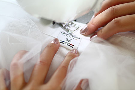 Etiquette Made in France Jupe tutu blanche courte devant et longue derrière en tulle