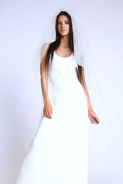 Robe de mariée longue évasée sans manche ivoire